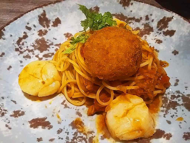 Scallop and crab croquettes with tossed spaghetti with chili crab sauce