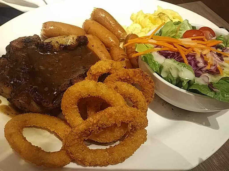Steaks mixed grille with sausages, garden salad and onion rings