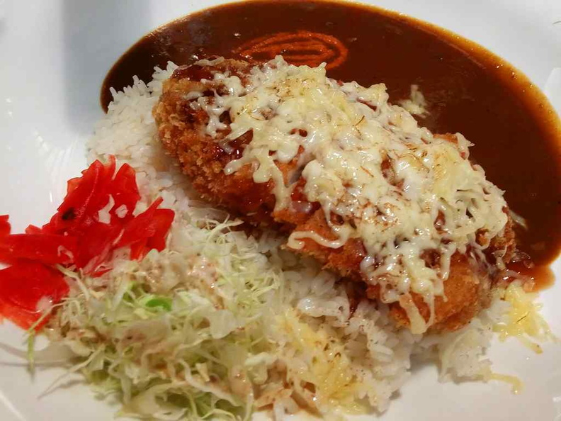 Your Coco Curry Ichibanya cutlet rice served with generous servings of shredded lettuce.