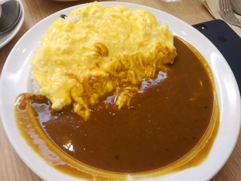 Check out the Omu (omelet rice) it is as basic a meal can get here besides their sausage curry rice