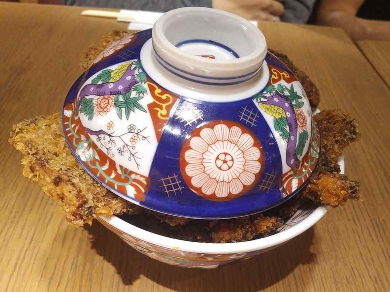 Your katsus are serving in small flower bowls. The pieces are large they are sticking out of the bowl