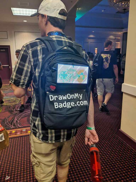 Plan your schedule in DEFCON to get the most out of the convention. There is alot happening at any time, like trying to draw on this guy's backpack