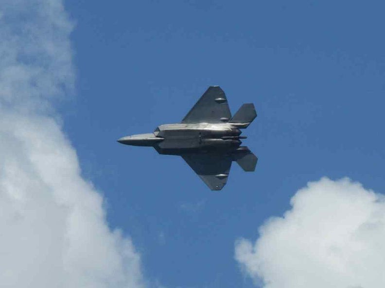 The F22 doing an undercarriage banked turn.