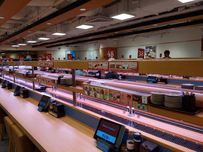 Yep, just like how a conveyor belt sushi place is, no frills here. It is the real deal