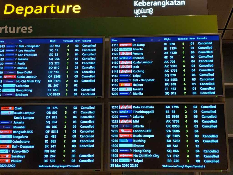 Changi Airport Covid-19 Boards of cancellations is common here in all terminals