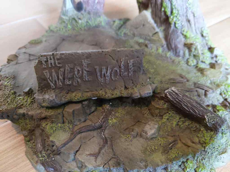 The sturdy base of the werewolf figure