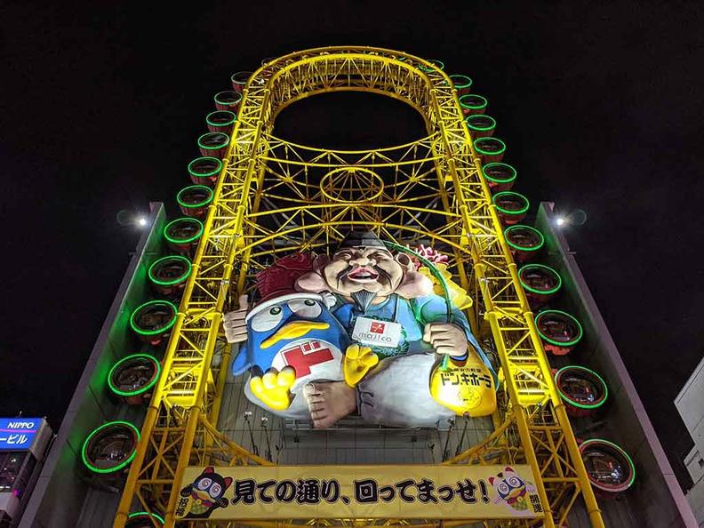 Don quijote dōtonbori main tower with the Ferris wheel