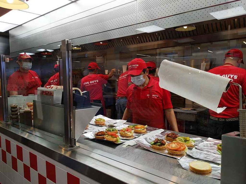 Five guys burgers kitchen runs like clockwork churning out tons of burgers at a go, especially on peak mealtimes.