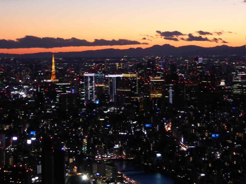 Tokyo skytree on the sunset with a growing sea of lights