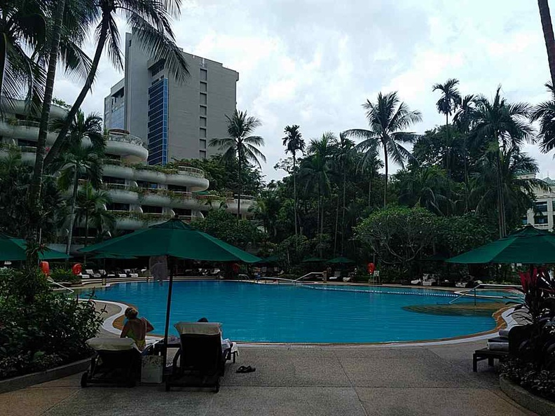 The pool are of the hotel, which the buffet area looks out upon