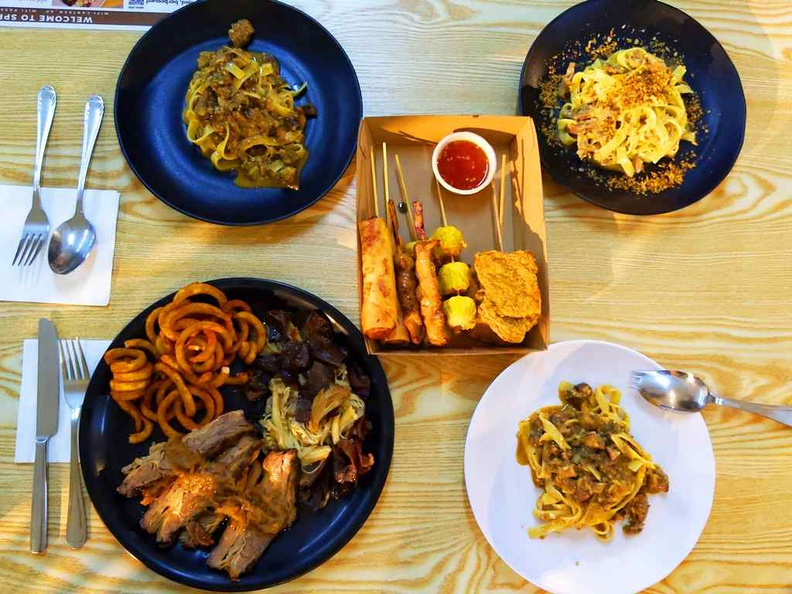 Meat and Greet beef brisket, pictured with pasta offerings and Asian skewers from Lok-kol