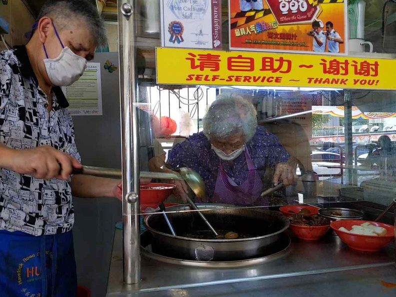 Mdm Chua at work, even after over 50 years behind the wok