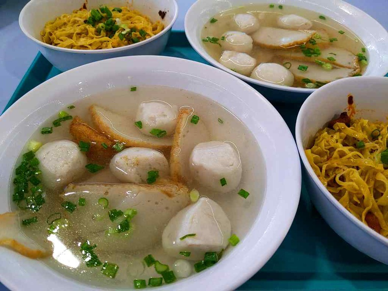 Ru Ji fishball noodles platter with servings of noodles dry and soup bowls