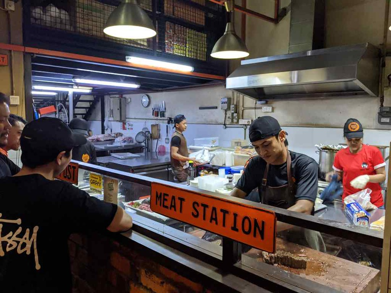 The open concept meat station where you can see staff working to prepare your BBQ