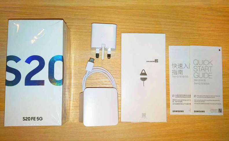 Basic box contents with included USB charger, cable and SIM tray pin