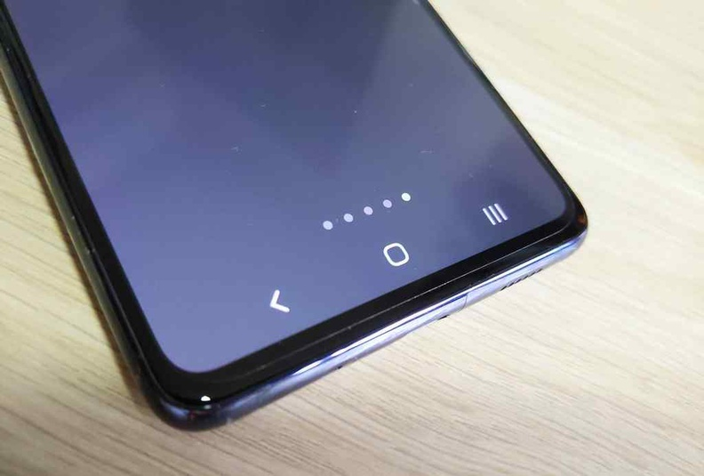 Samsung's traditional Android 3 button action keys in place of the 2 button one