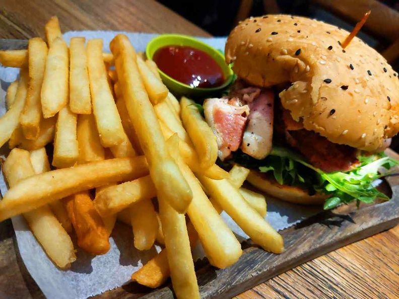 All their burgers come with BBQ sauce, salad, pickles, sitting between sesame buns and served with fries as sides