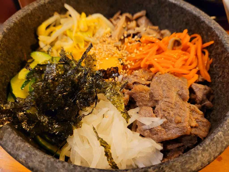 Wonderful Bap Seng Bimbimbap ($12.80) a potpourri mix of hearty meat and vegetables ingredients in a heated hotstone bowl