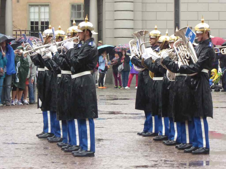 The Guard band playing their piece at every change of guards parade, rain or shine
