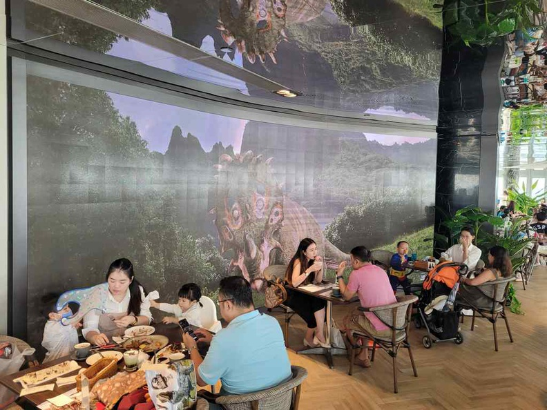 Jurassic World Cafe Ion Sky Dining area with the ambient static dinosaur background