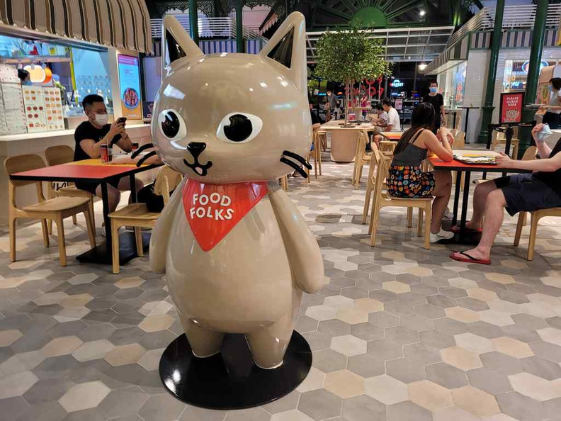 Welcome to Food Folks Lau Pa Sat, with their cat mascot