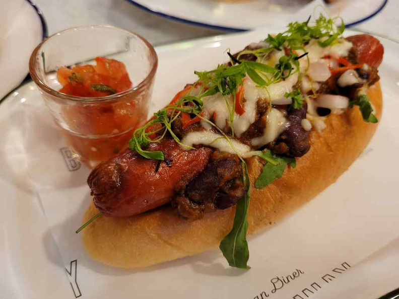 Chilli Beef Hot Dog ($10) with smoked taste and topped Chilli Con Carne, Pico De Gallo and Mozzarella Cheese