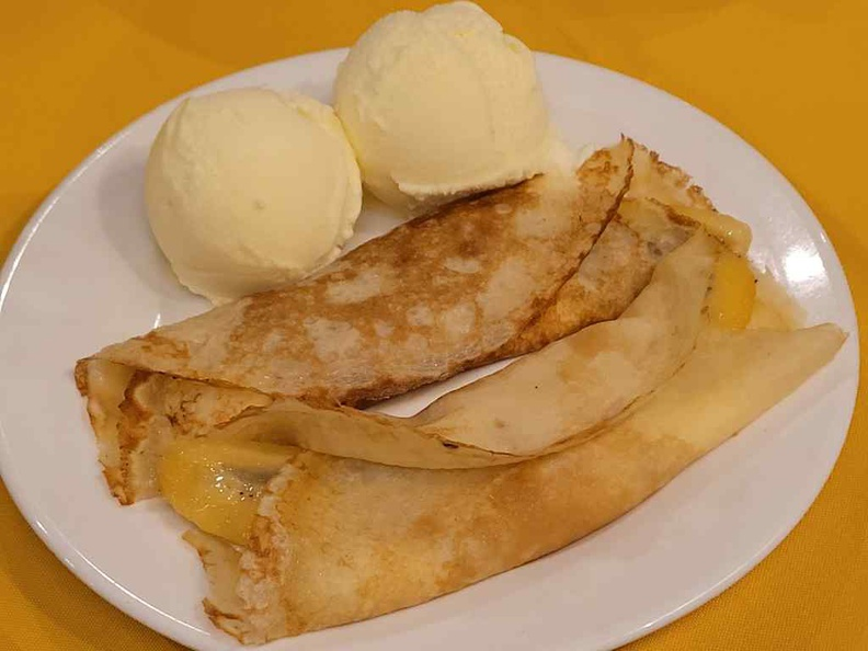 Fancy Pancake ($14) is a caramelised banana dessert, brushed with freshly whipped cream and wrapped in homemade crêpe, served with ice cream