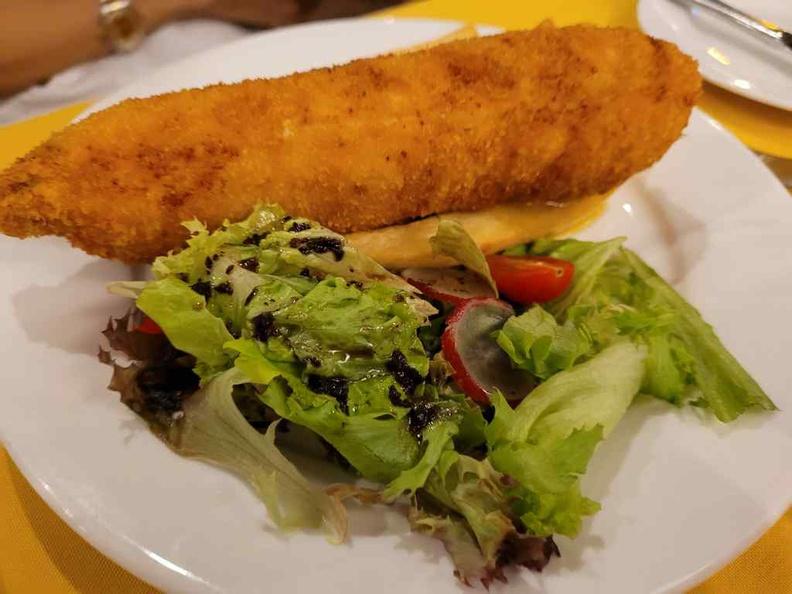 Chicken à la Kiev ($28) is a breaded chicken dish served with vinegar salad