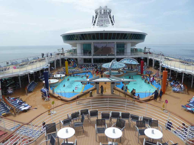 The top floor pool area of the Royal Caribbean Mariner of the Seas, with the Singapore skyline in the distance