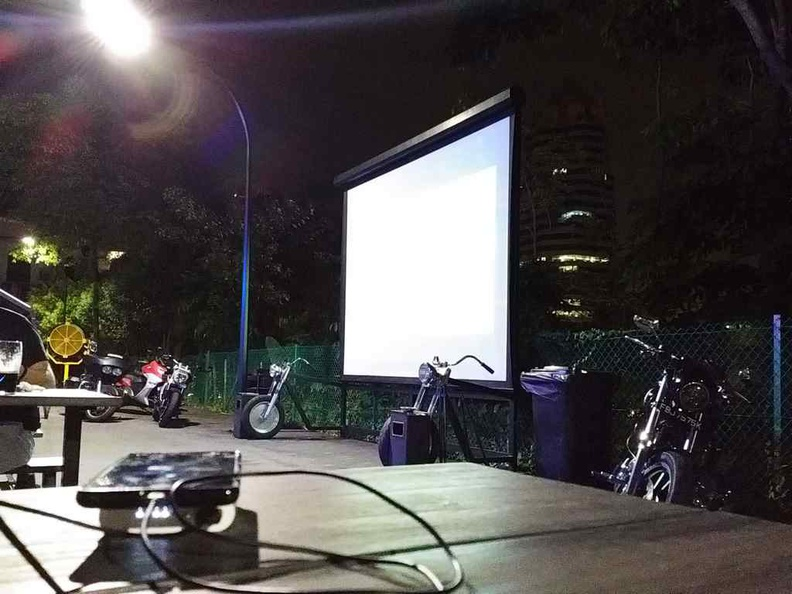 Outdoor screening projection in their rather dark outdoor dining areas