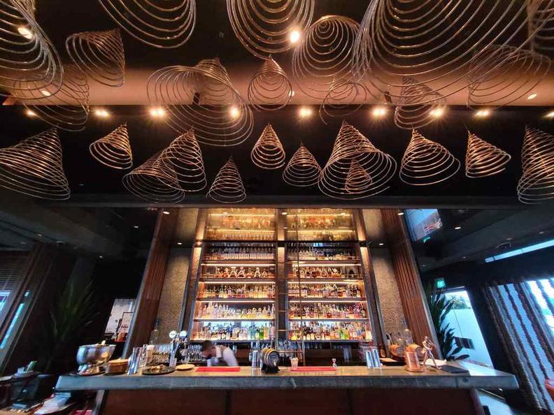 Ce va li Indoor bar with an incense style top hangers