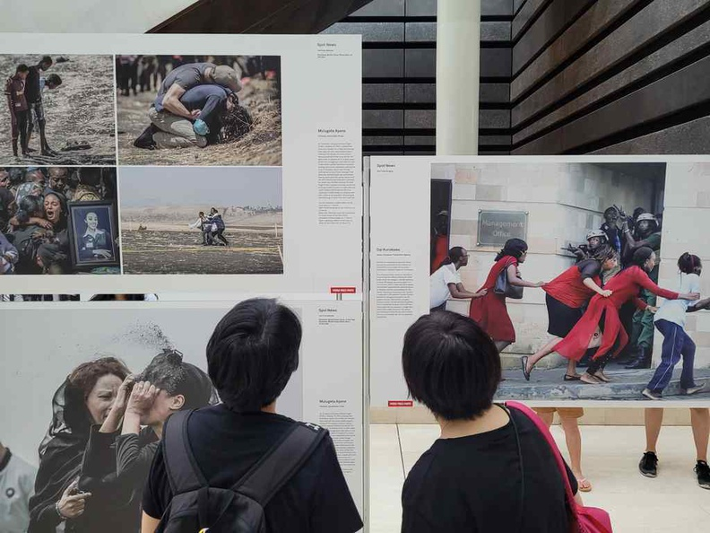 Members of the public checking out stories which mattered, a recollection from the past year of press photos
