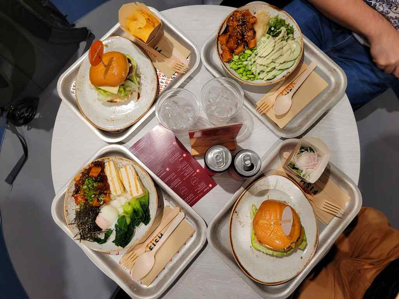 You dishes at pink fish changi jewel are served on small neat metal trays with sustainable cutlery