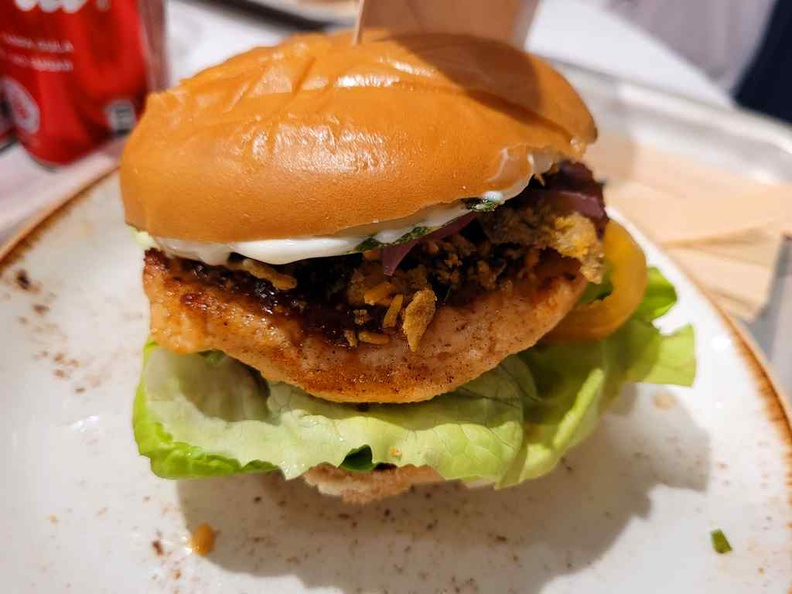 Singaporean burger ($9.90) loaded with Sambal slaw, pickled onion, cucumber and salted egg