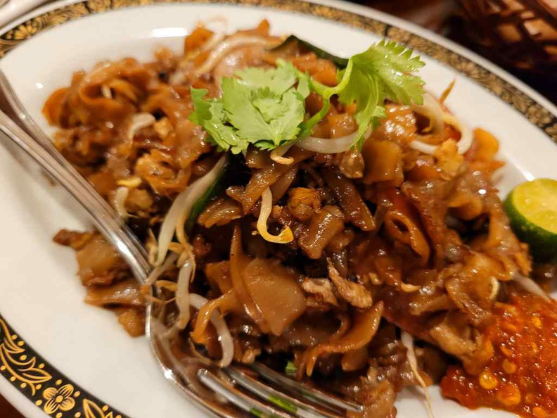 Free flow of Char Quay Teow, a sinful gastronomical affair. Served with chili sand lime