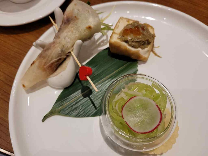 Huating Restaurant appetizer with Chilled Asparagus Lettuce, Enoki Mushroom, Truffle, stuffed bean curd, crab Roe, smoked duck and hand roll