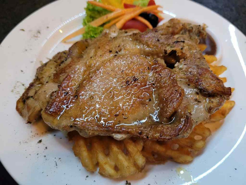 TG Bistro Chicken chop served with waffle fries and salad