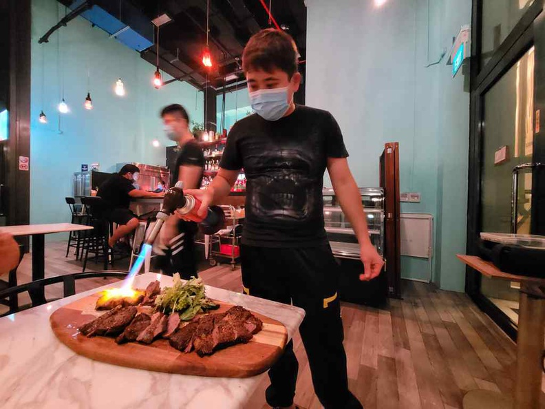 Your combination steak platter ($100) is flame grilled in front of you
