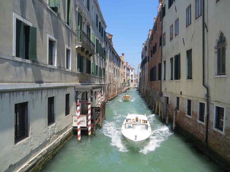 Boats navigating the various narrow canals between the various Venice districts