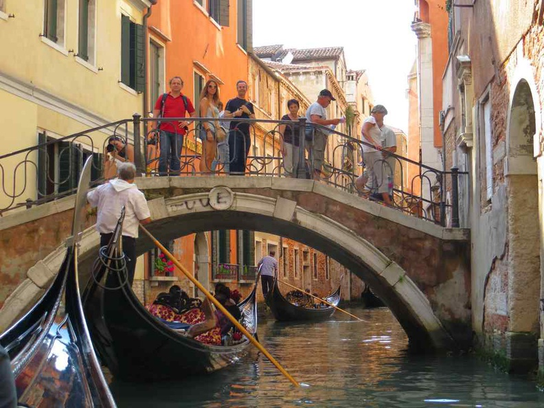 a convoy of tourist gondolas on the prowl on the Venetian river in Venice Italy