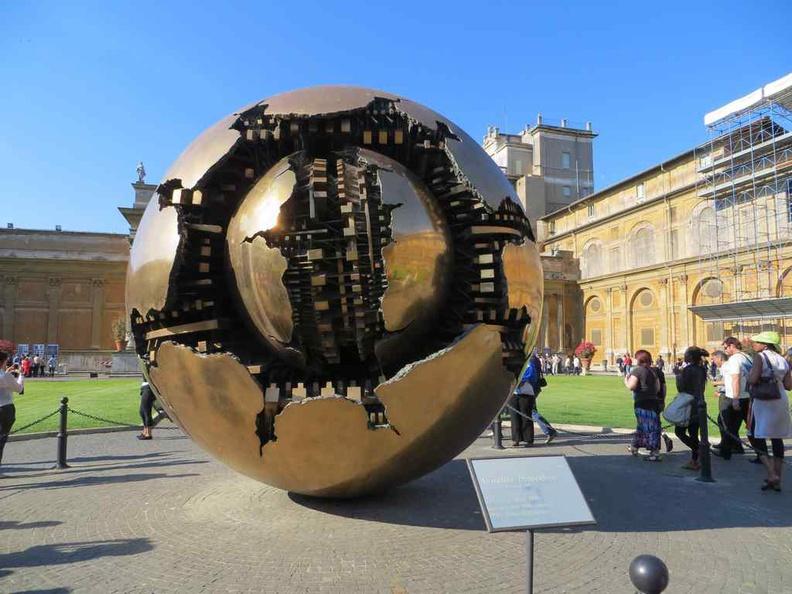 Sphere Within Sphere sculpture by Pomodoro in the Cortile della Pigna