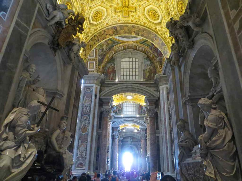St. Peter's Basilica main walk way and roof murals at the Vatican city
