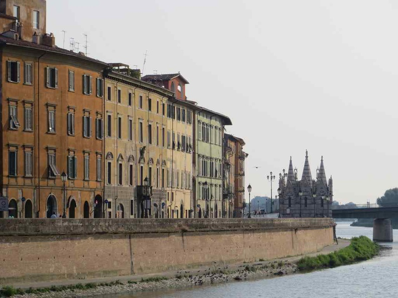 View along the Pisa river Arno with Pisa Italy gothic cathedral Santa Maria della Spina in view
