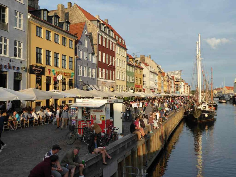 Copenhagen Denmark Nyhavn food area and historic wharf is full of restaurants and pubs. A very touristy spot