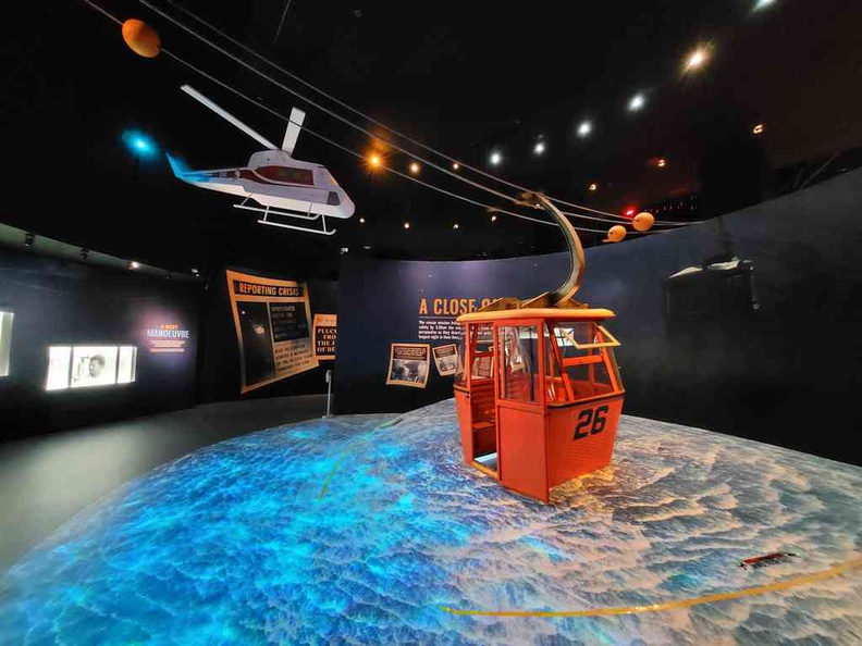 Exhibit area of the 1983 Sentosa cable car incident at the Discovery Center through lens of time