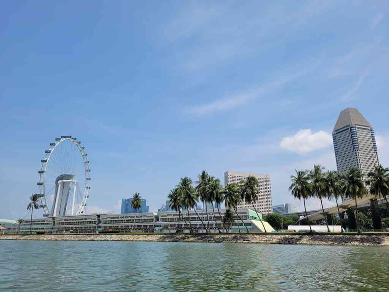 A duck tours view of the Formula 1 put building and Singapore Flyer from the water