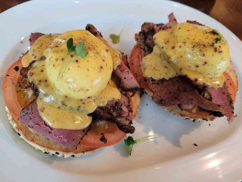 Delancey ($28)- hand-sliced beef pastrami, served with poached eggs, tomatoes & grain mustard Hollandaise on a sesame bagel