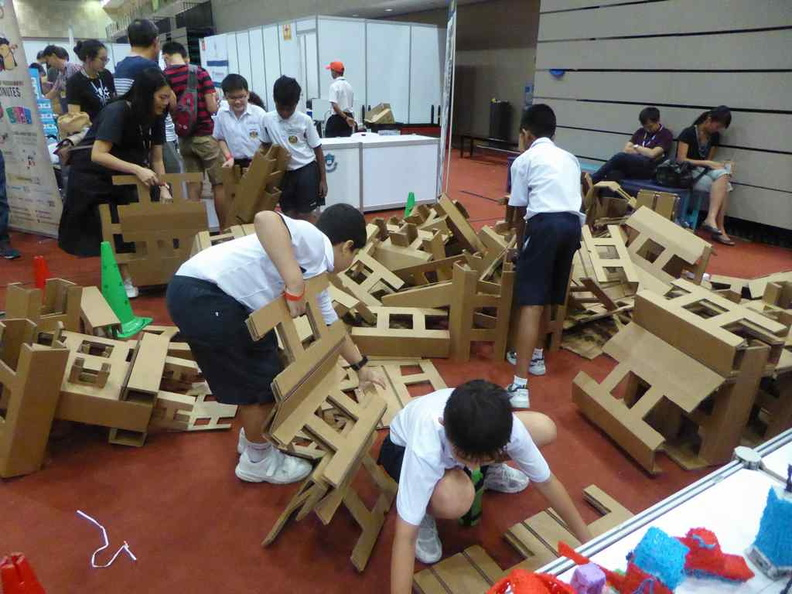 Students constructing structures at the Cardboard Octomaker