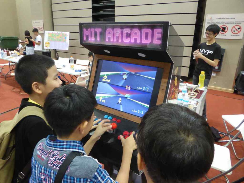 NYP with their retro-fied Arcade gaming machine, a hit with the kids