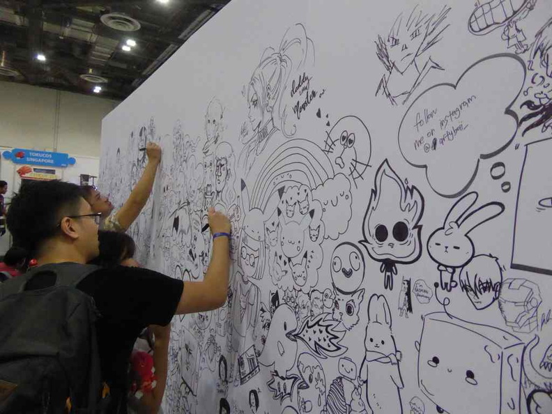 The STGCC Doodle art wall is brimming with artwork contributed by anyone with a pen wiling to doodle onto it